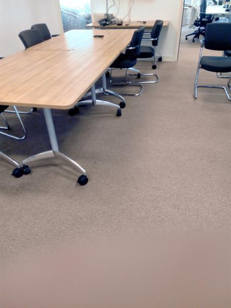 Picture of boardroom carpet after we had restored it.